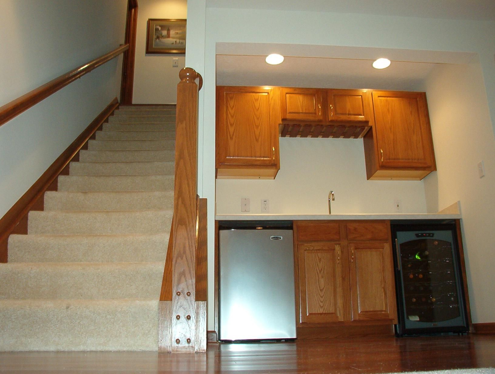 Basement Bar Remodeling Ideas Open Carpeted Stairwell With Banisterbar Area With Countertop
