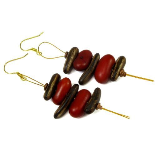 * * Drop earrings featuring fire tree seeds and frijole rojo seeds * Seeds are on gold tone cable earwires with tails measuring about 2 1/2 inches long * Both seeds come from South America * Designed