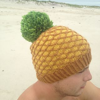 dfc619ddb51 Show your love of fruit with the Pineapple Hat! Use any light yellow and  brown worsted weight yarn from your stash
