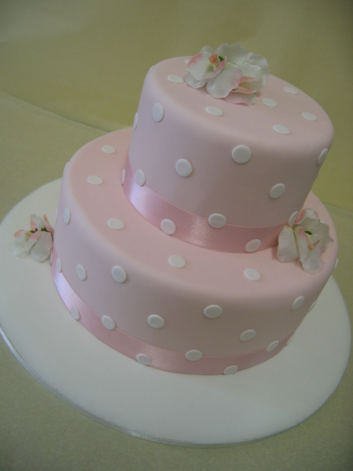 make a statement with a twotiered cake with white polka dots on
