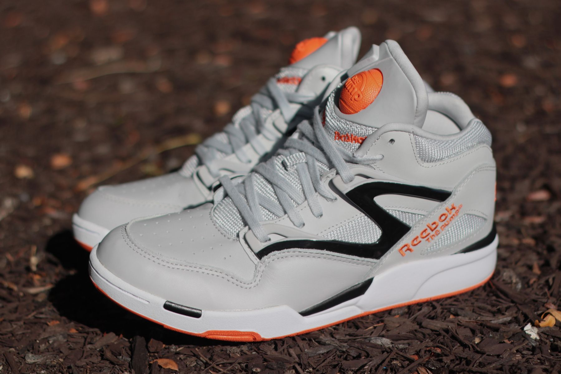 fabf4764605 The Reebok Pump Omni Lite gets a Steel and Orange Swag color up ...