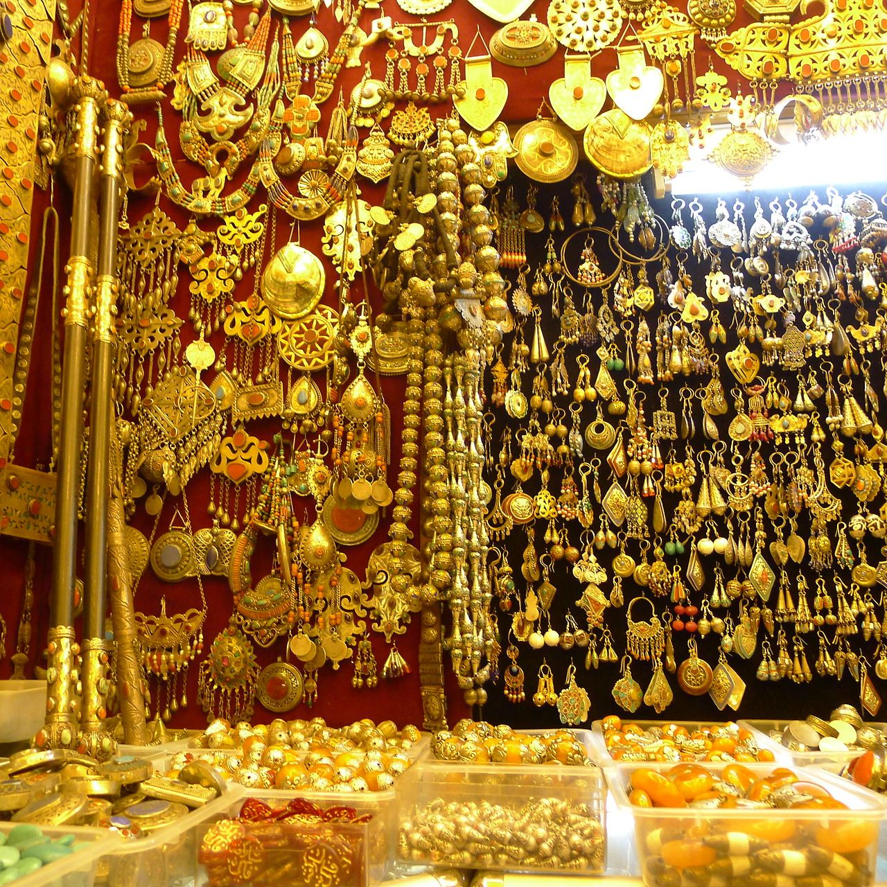 Cher Coulter's Travel Diary- Intricate gold jewels line the walls of a Turkish vendor. #CherForJewelMint