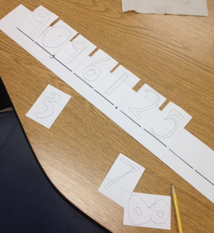 Use sentence strips to help students conceptualize place value and ...