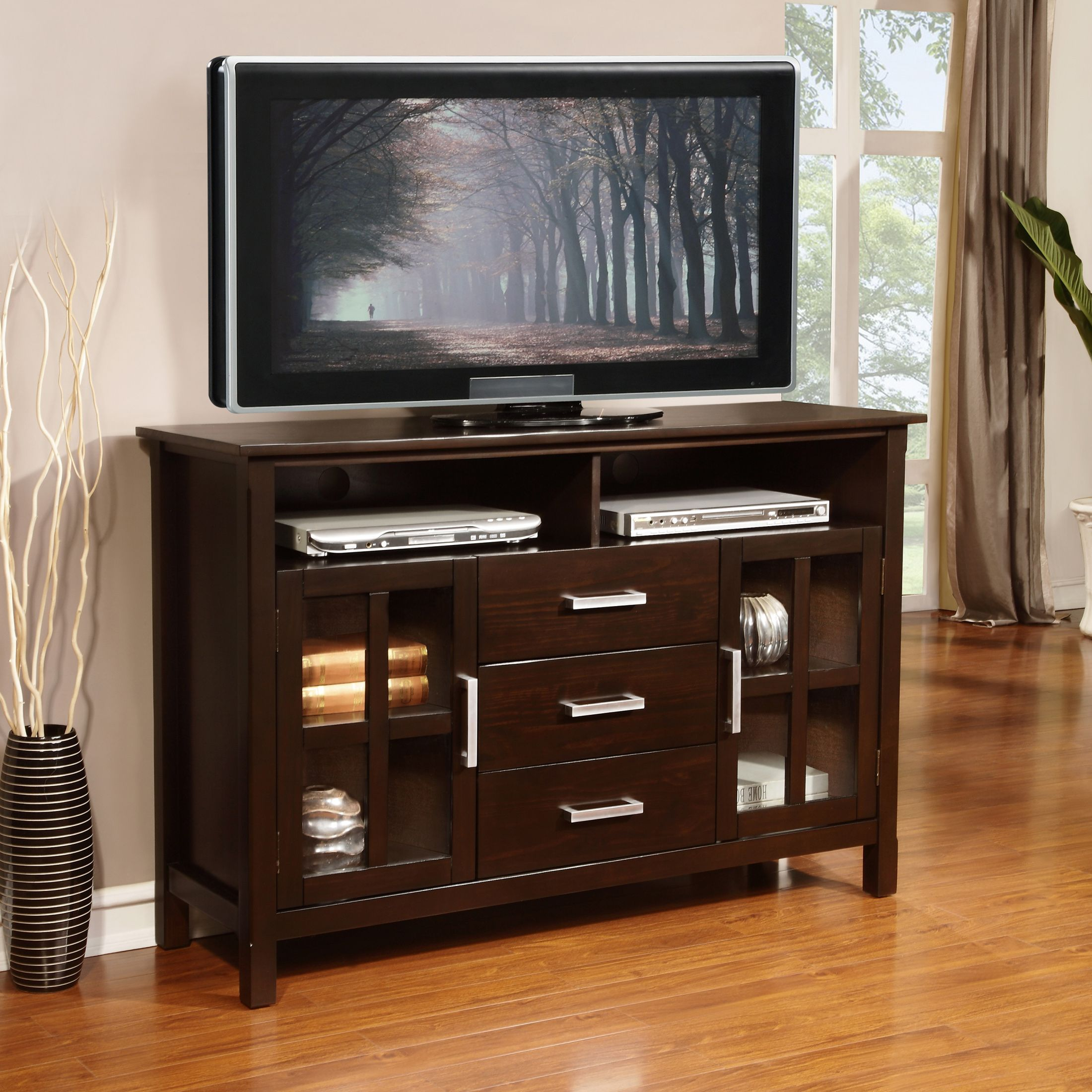 Complete Your Living Room With The Contemporary Elegance Of The Waterloo Tall Tv Stand A Large Central Top Open Area Tall Tv Stands Simpli Home Tv Stand Wood