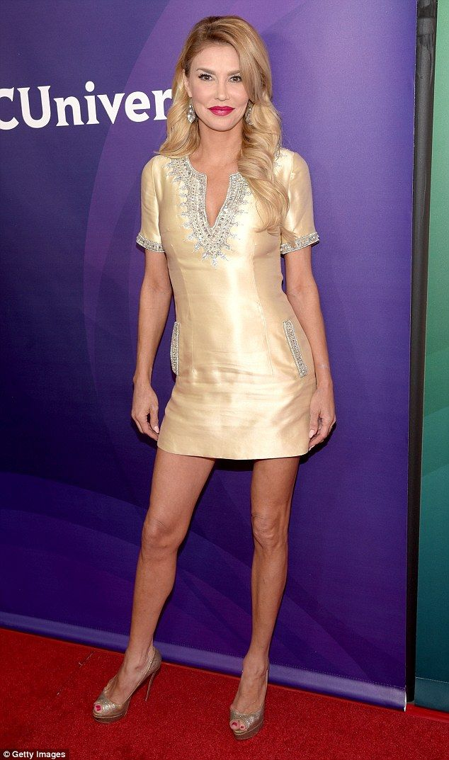 Brandi Glanville flaunts long tanned and toned legs in gold mini-dress