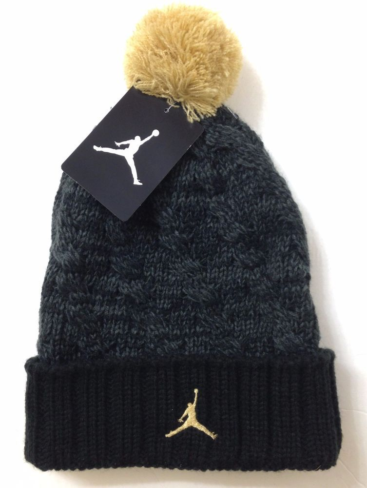 04a1ebda3c2 Ladies AIR JORDAN JUMPMAN POM BEANIE Dark Gray Black   Gold Winter ...