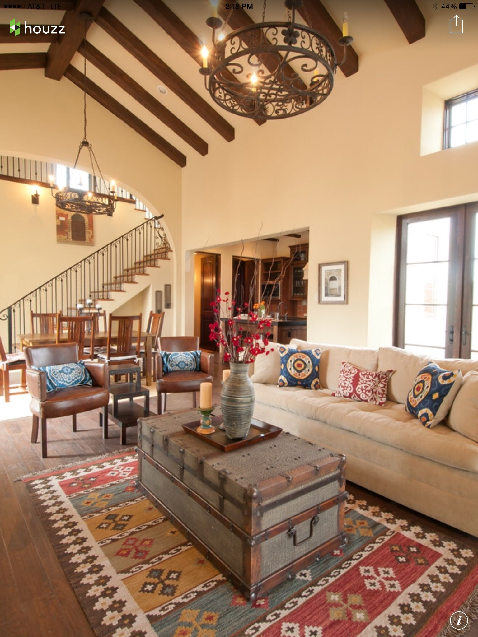 The Combo Of The Kilim Rug Pillows Rustic Chandelier Wood Beams And Old Trunk Gi Mediterranean Living Rooms Mediterranean Interior Design Family Room Design