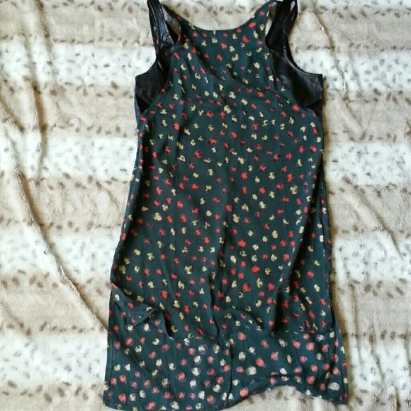 Long Tank with faux leather detail Never worn. Cute tank polyester material. Longer in back past butt. Paper Crane Tops Tank Tops