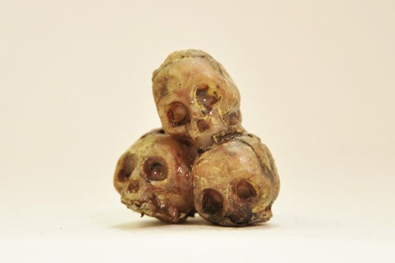 Pile of Skulls 1-inch scale dollhouse miniature. $5,00, via Etsy.