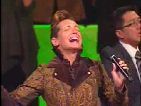 Gina McCool leads the Pentecostals of Alexandria in a song