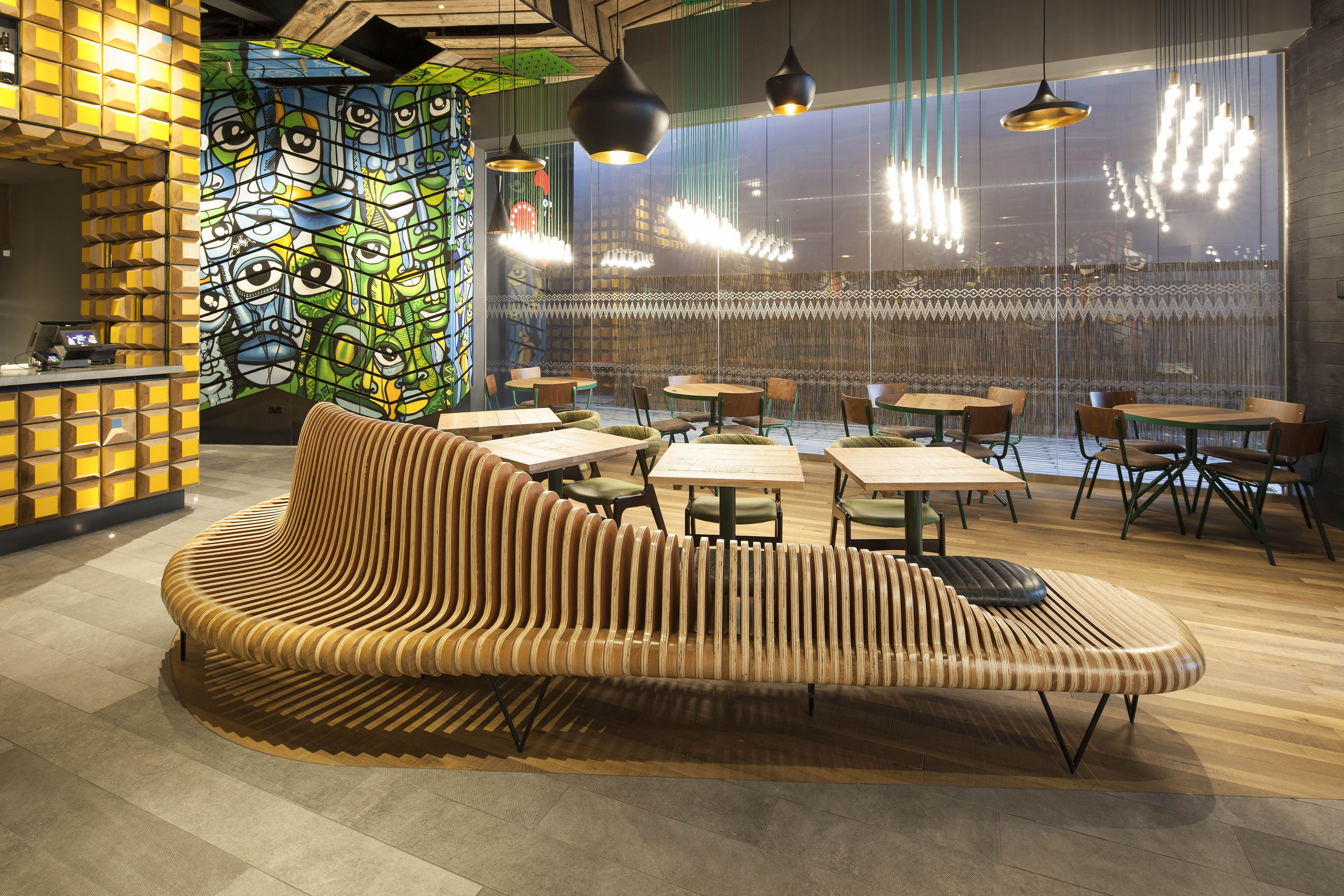 Project: Nandos Teesside  Location: Teesside  Client: Nandos  Interior Design: STAC Architecture  Lighting Design: Enigma Lighting  Enigma Lighting Products Used: Filament Lamps  Images: Rocco Photography