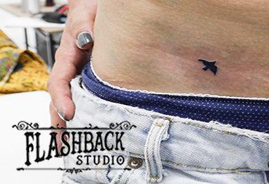 Tiny blue jay tattoo on stomach