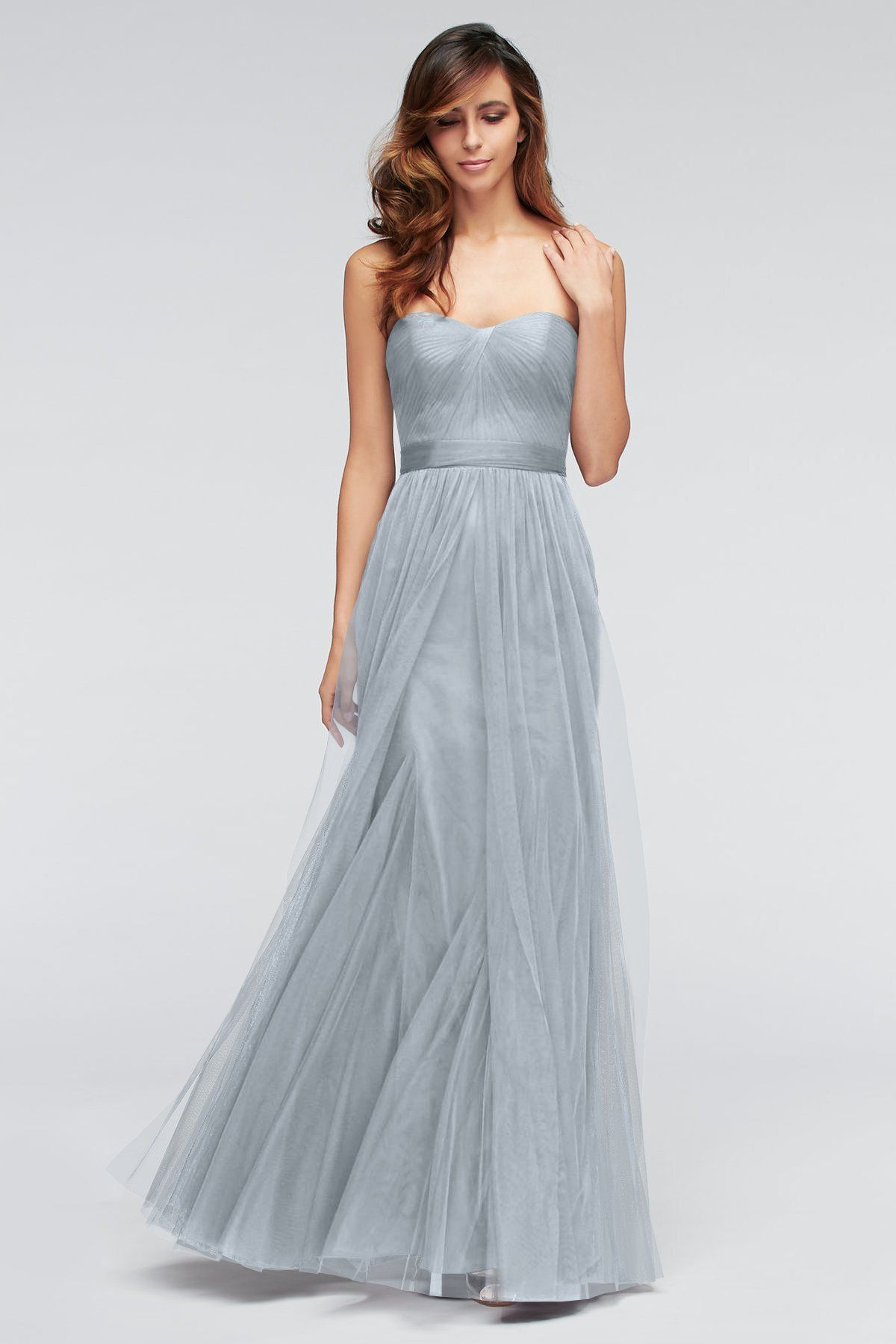 A sweetheart neckline and fluttering layers on the skirt make Heath ...