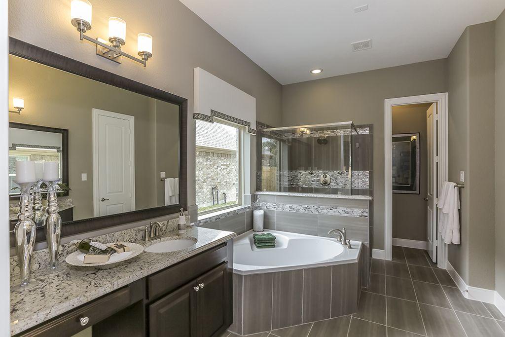 Gehan Homes Master Bathroom White Granite Dark Cabinets Gray