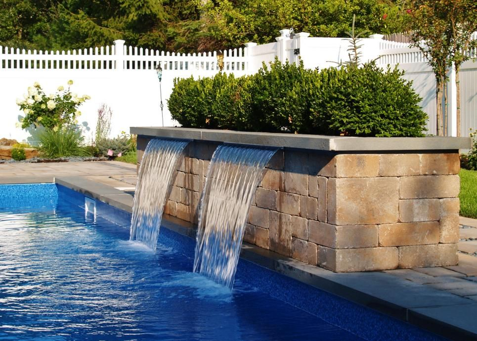 Backyard pool with waterfall filter feature pool