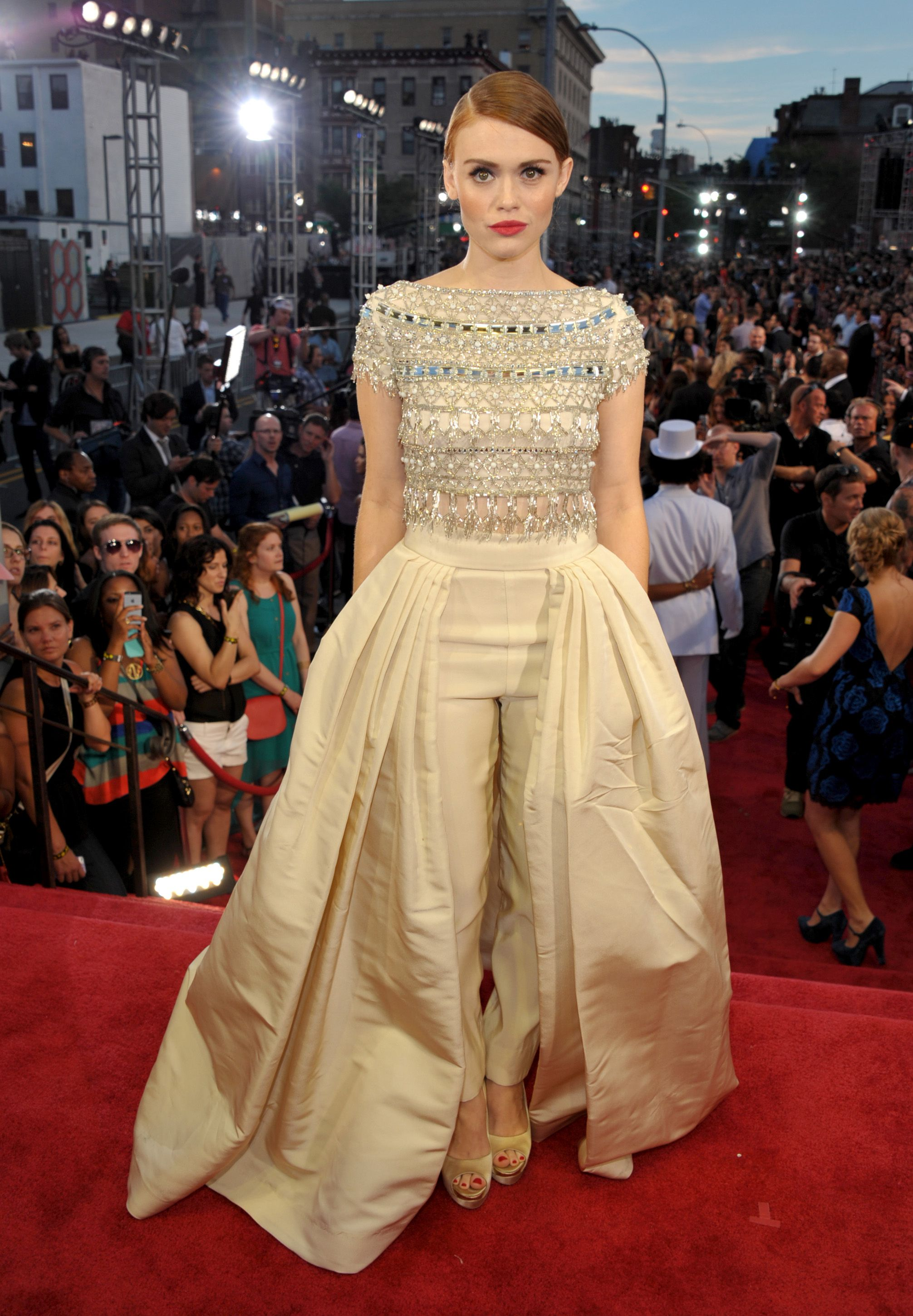 """Fashion hits and misses: The 2013 MTV Video Music AwardsFor decades, designers have been trying to hybridize pants and dresses (no, we don't know why). The experiment continues with """"Teen Wolf"""" starlet Holland Roden, who dons a delicate, champagne-hued Naeem Khan ballgown-trouser combo topped with a sophisticated beaded bodice. Vote on her look, then see who else modeled pants ..."""