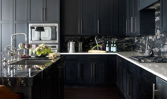 Instead of opting for the tried-and-true all-white design in the kitchen, take a cue from these top designers and opt for an unexpected yet equally elegant look with black cabinetry.