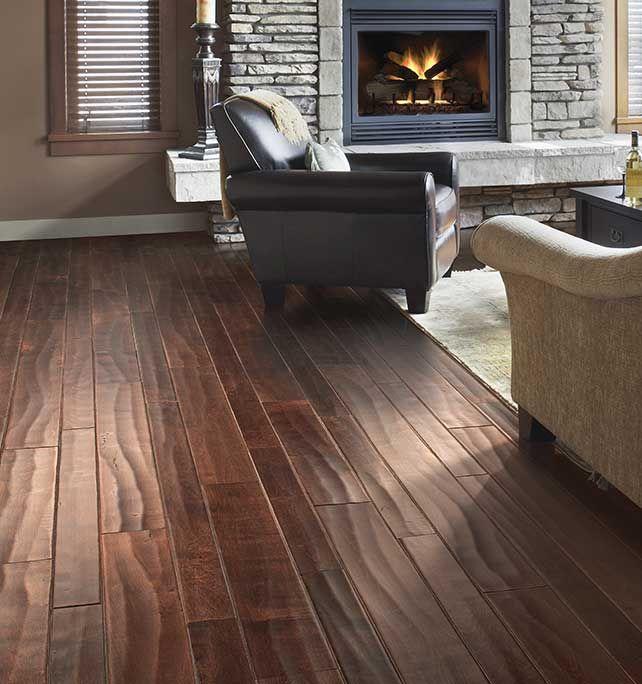 Handscraped Hardwood In Dark Brown Creates A Rustic Yet Refined Look Rustic Wood Floors Hardwood Floors Flooring