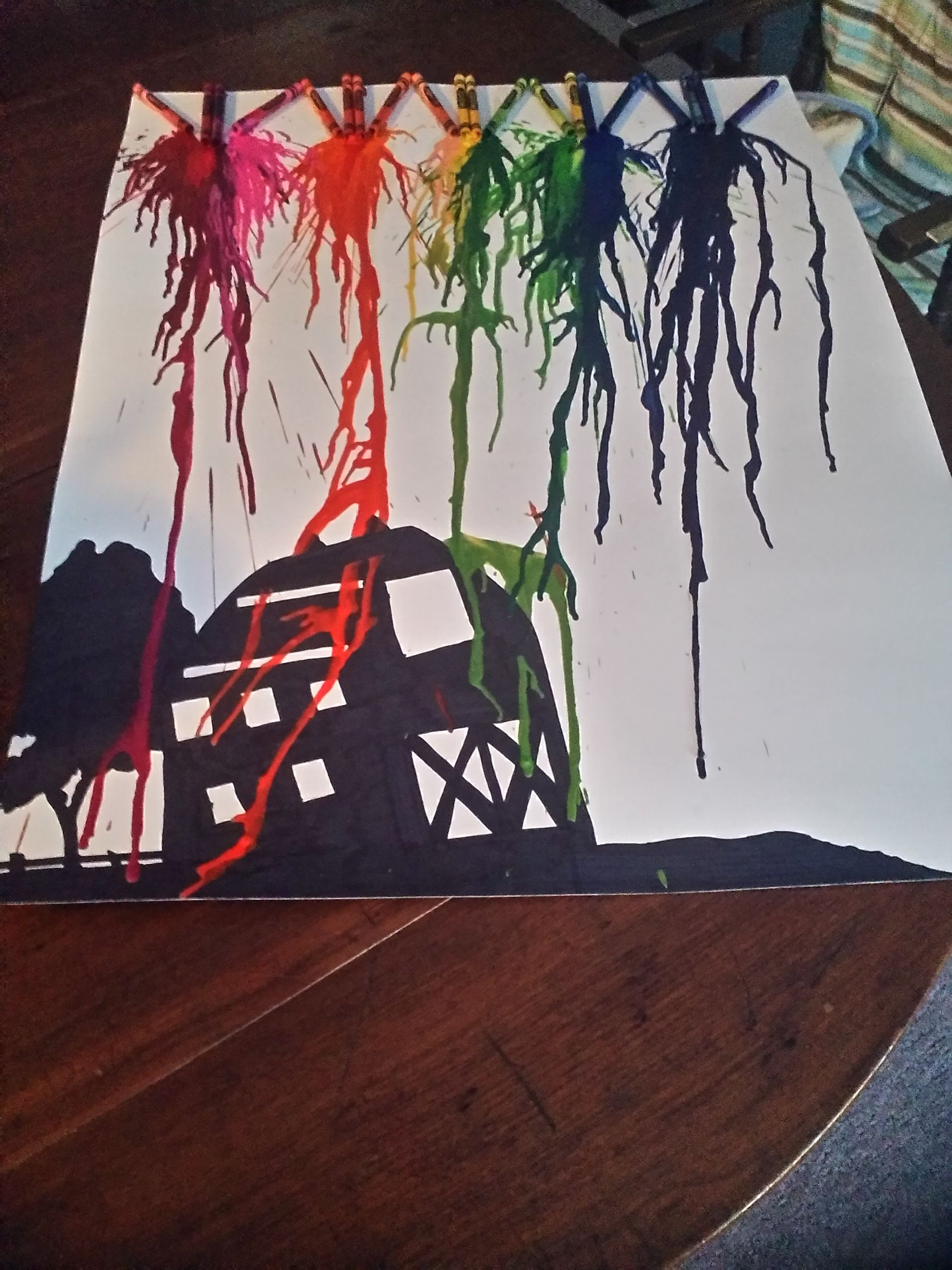 melted crayon w/ sihlouette of a barn