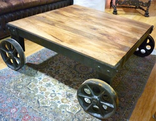 Timbertop industrial style coffee table w cast iron wheels