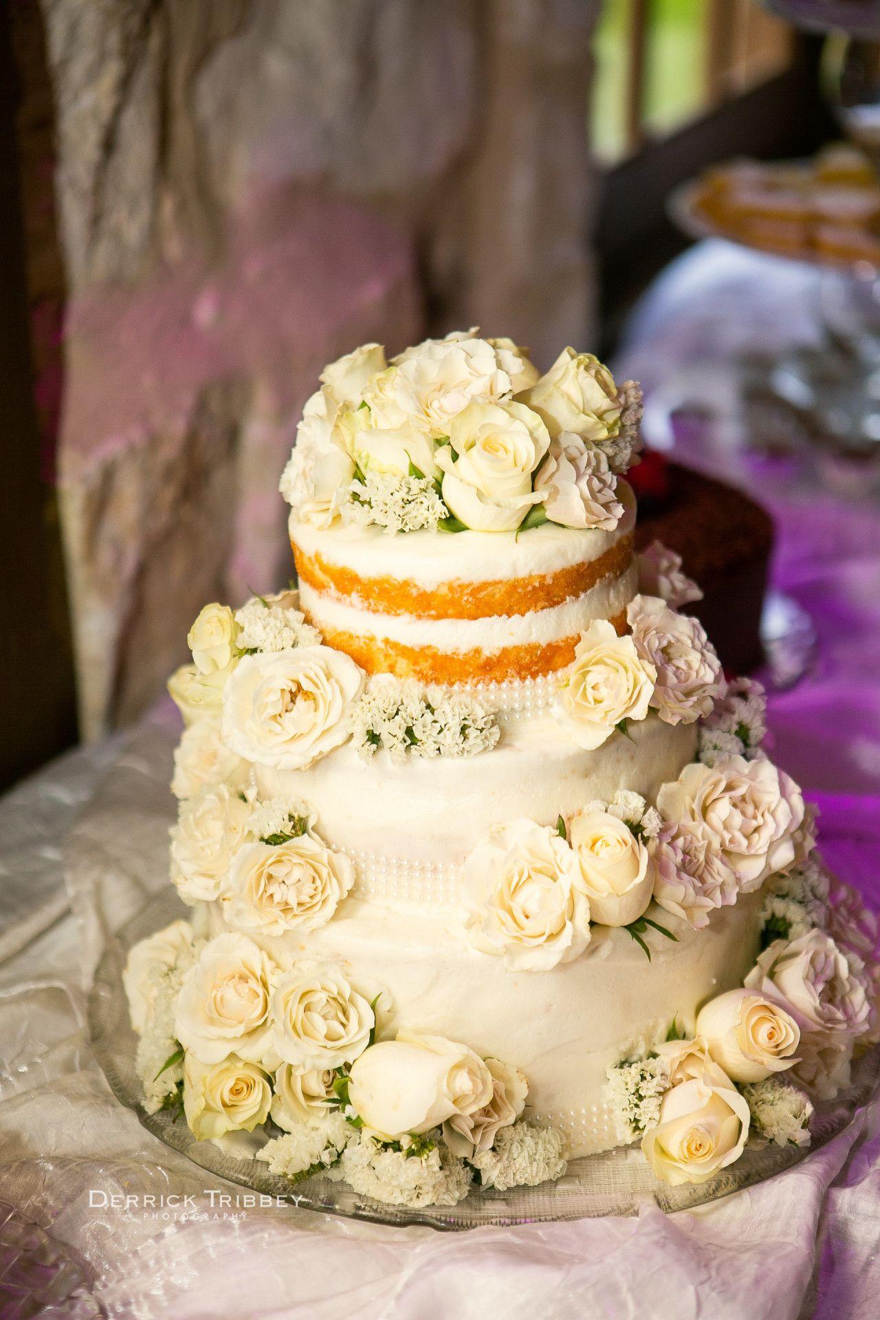 Maroon and cream wedding decor  naked ivory wedding cake  half naked half frosted wedding cake