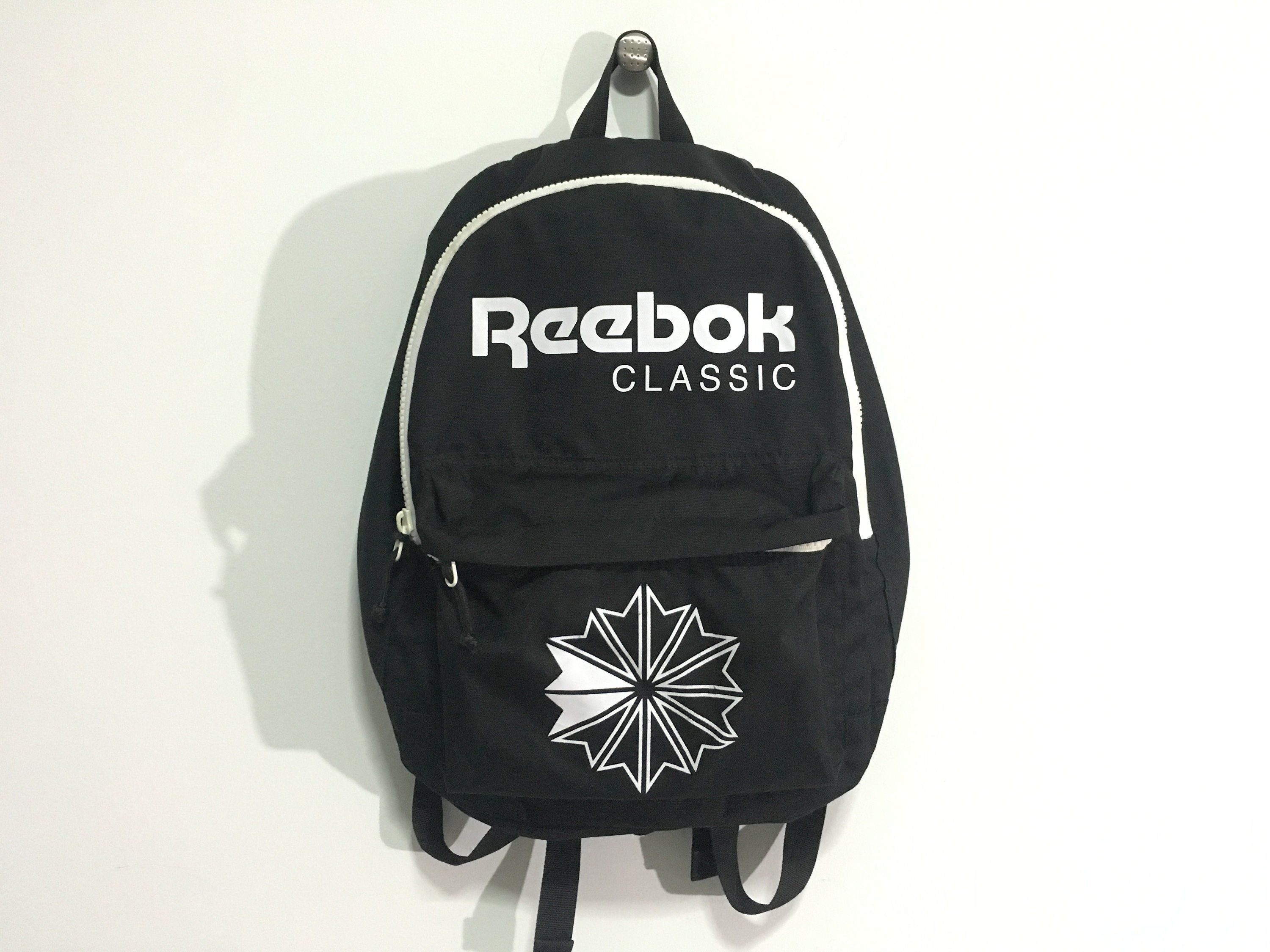 d0ec790f5a65 Vintage Reebok backpack Reebok classic big logo spell out bag Black White  Excellent condition by AlivevintageShop