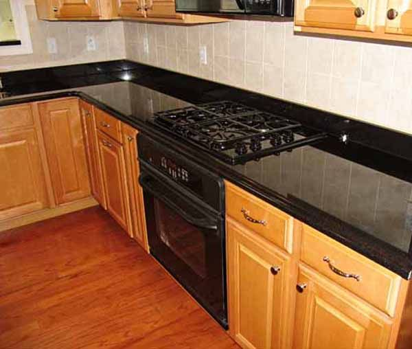 image result for backsplash with black granite countertops