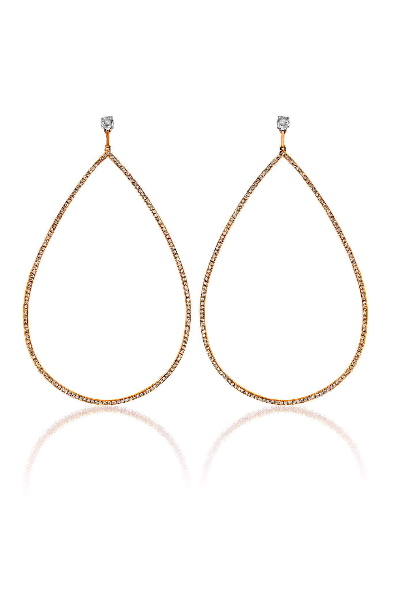 "Seductive glamour is the buzzword with Haute Vault's oversized 18K rose gold and diamond teardrop earrings. For maximum exposure, sweep your hair to the side and show off this beautiful silhouette. Measures 3 1/4"" long and 1 7/8"" wide. Available for rental at www.hautevault.com"
