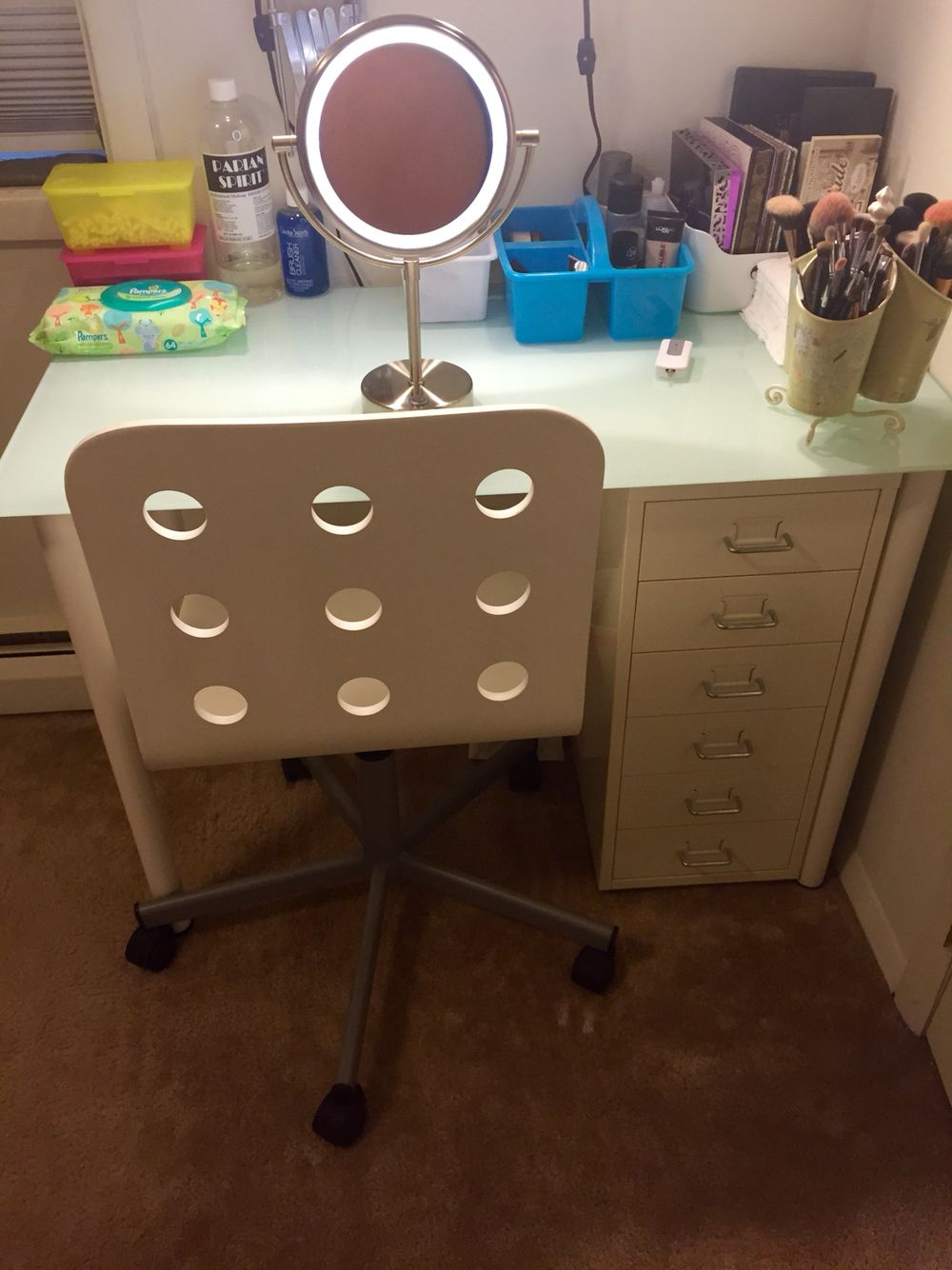 Makeup vanity from IKEA the Glasholm glass top with Adils legs