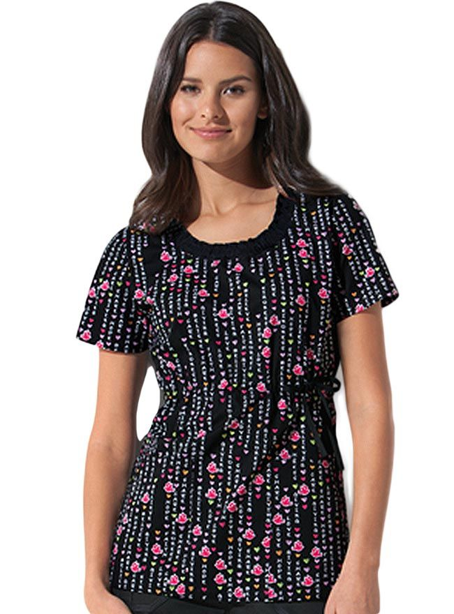093a19b0c9a Style Code: DI-82803KI A Junior fit top that features a smocked round  neckline, a front tie at the waist for an adjustable shape, patch pockets,  ...