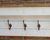 Handmade up-cycled pallet and floor board cot rack with antique copper plate hooks.