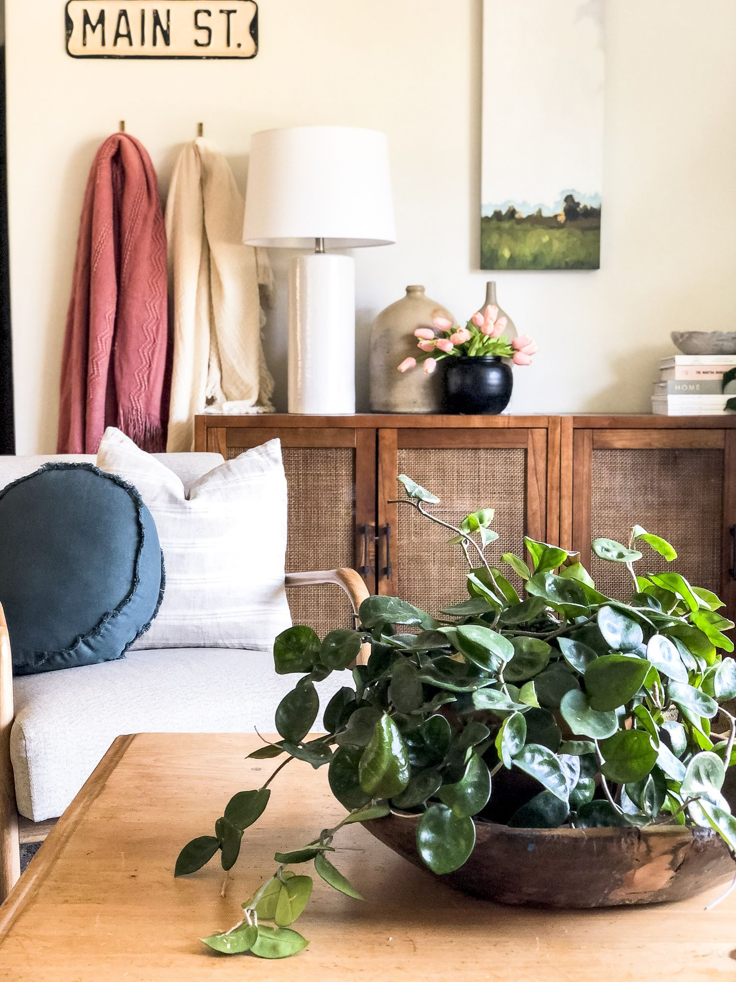 Learn how to get the modern bohemian design style with simple design tricks! Enjoy this summer home tour of my modern boho living room decor. #modernboho #bohemiandesign #modernbohemian #bohodesignstyle #summerdecor #livingroomdecor #livingroomlayout #velvetcouch