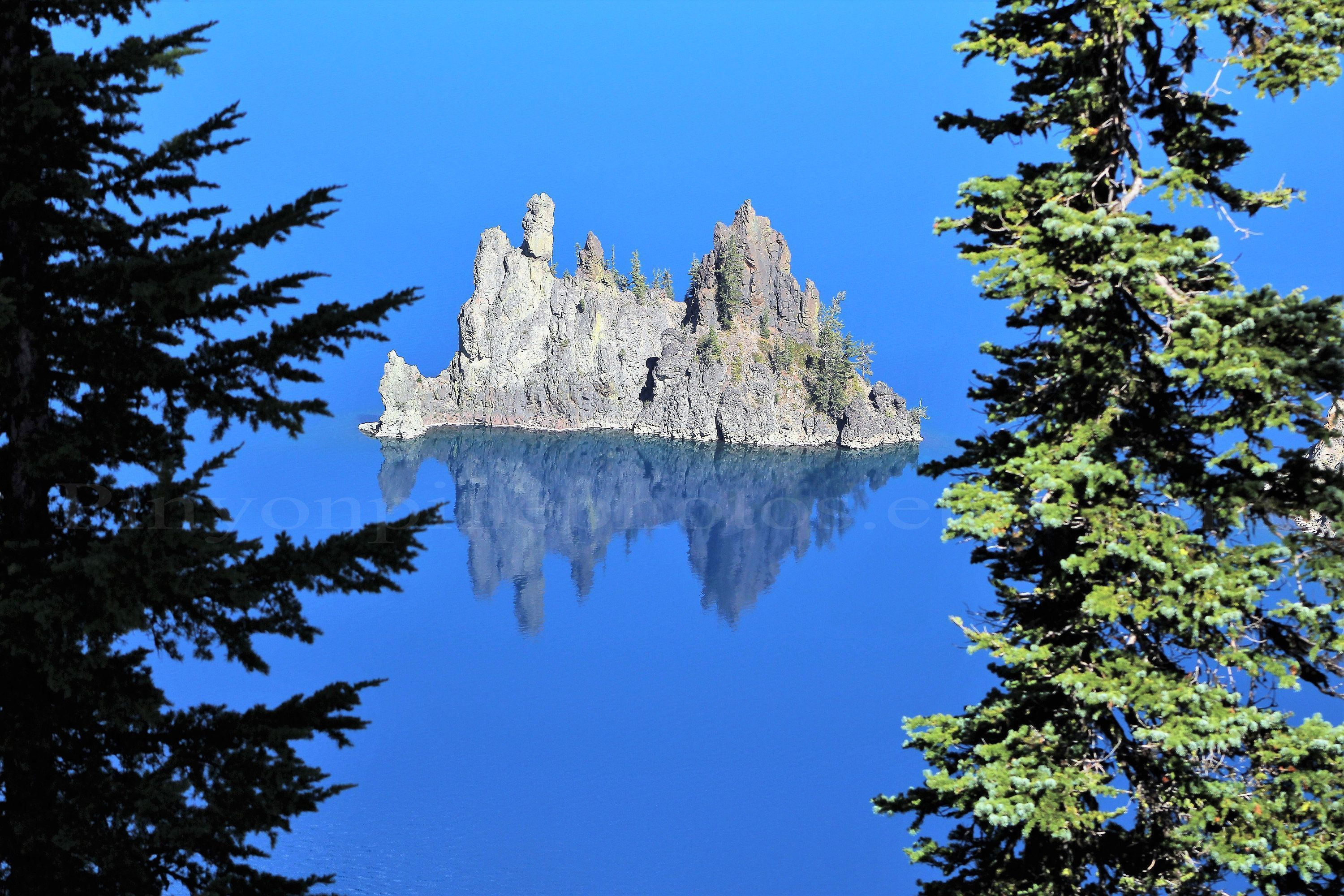 Phantom Ship Rock in Crater Lake National Park. Available in a fine art print, gallery wrapped canvas or photo greeting card #craterlakenationalpark Phantom Ship Rock in Crater Lake National Park. Available in a fine art print, gallery wrapped canvas or photo greeting card #craterlakenationalpark Phantom Ship Rock in Crater Lake National Park. Available in a fine art print, gallery wrapped canvas or photo greeting card #craterlakenationalpark Phantom Ship Rock in Crater Lake National Park. Avail #craterlakenationalpark