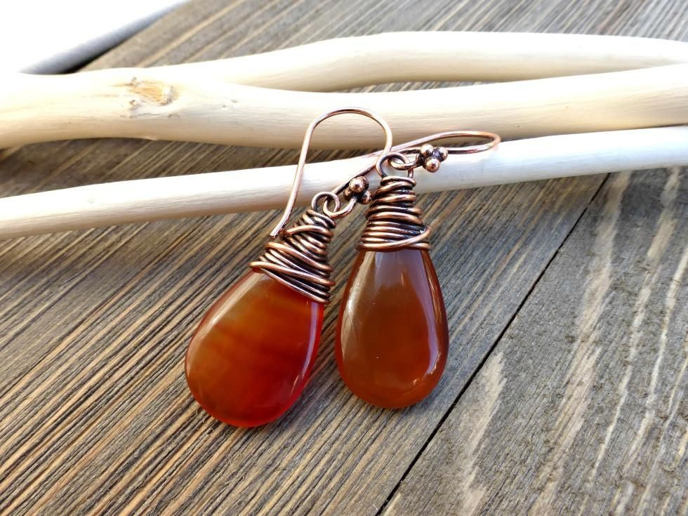 Teardrop orange agate stone wire wrapped copper earrings. Stone and metal.