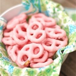 1 bag of miniature pretzels  2 cups strawberry or vanilla yogurt  5 cups confectioners sugar Preheat oven to 250°F.  In a large mixing bowl, mix the confectioners sugar into the yogurt one cup at a time with a hand blender.  Using tongs or chopsticks, dip the pretzels, one at a time into the frosting and place them on the wire cooling rack.  (Place a cookie sheet under the wire rack to catch the excess frosting that will drip from the pretzels.)  Once all pretzels are coated, turn your oven…