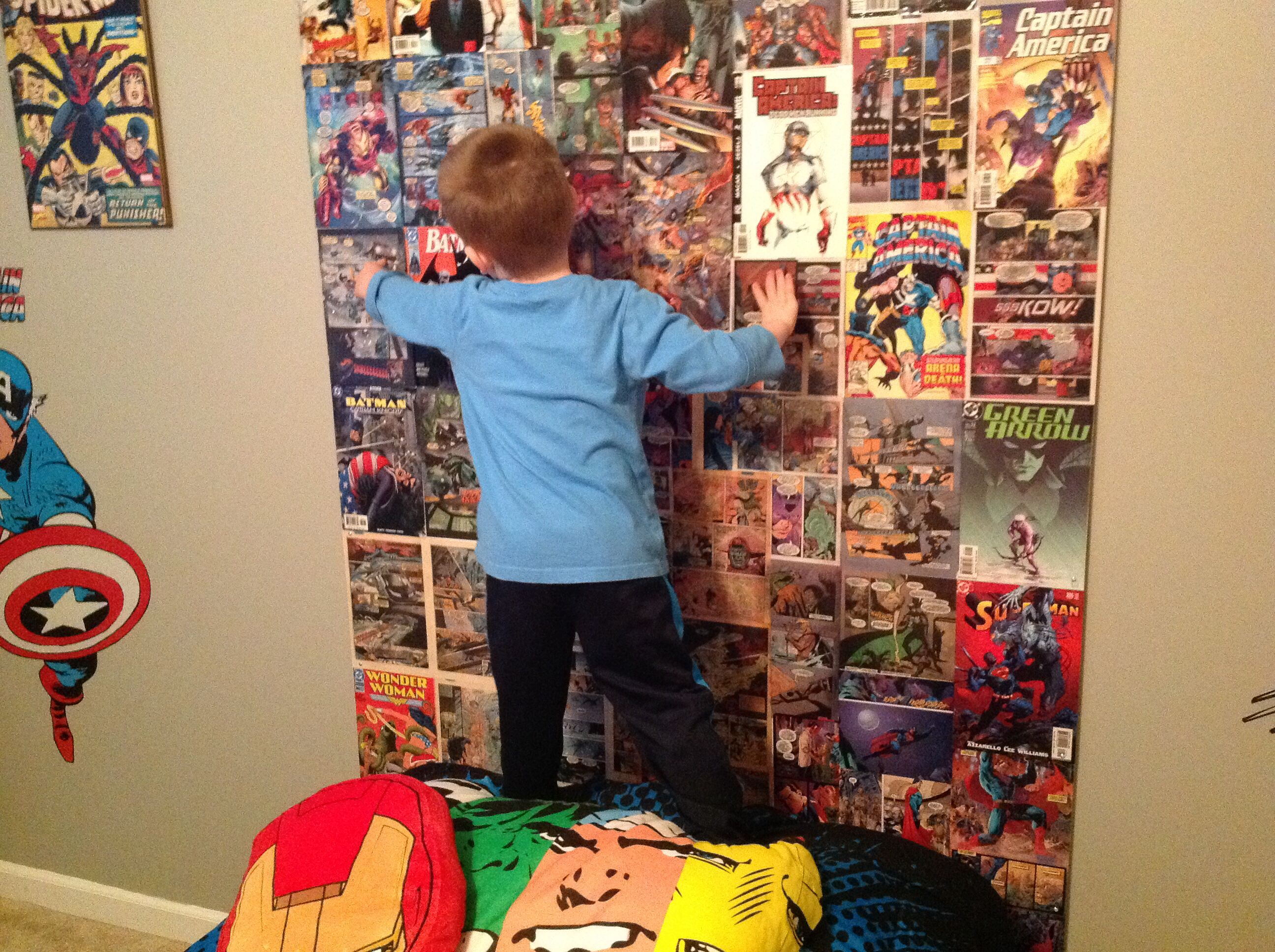 My sons super hero bedroom homemade backboard from ic books I