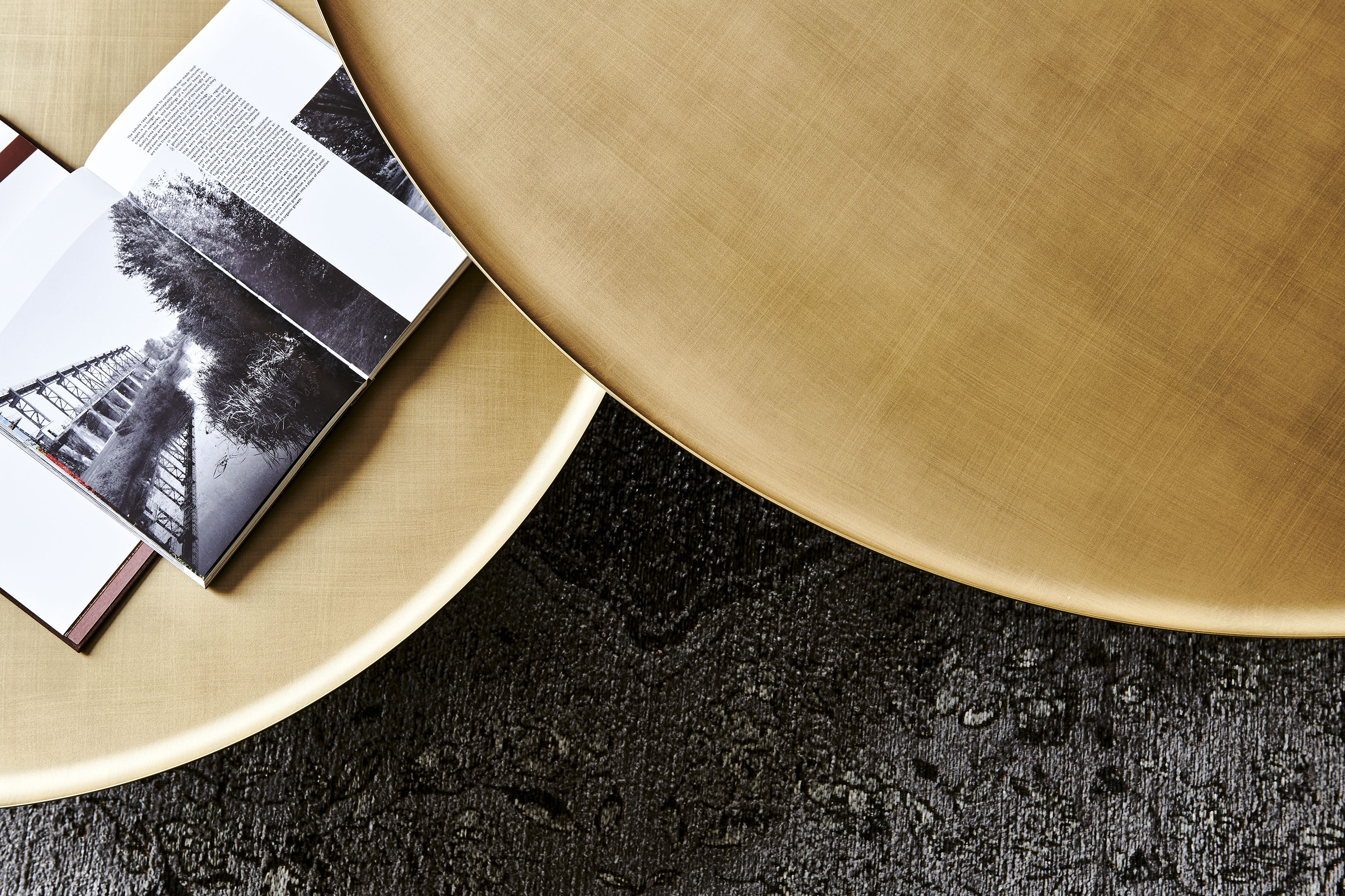 Coffee table with base in titanium embossed lacquered
