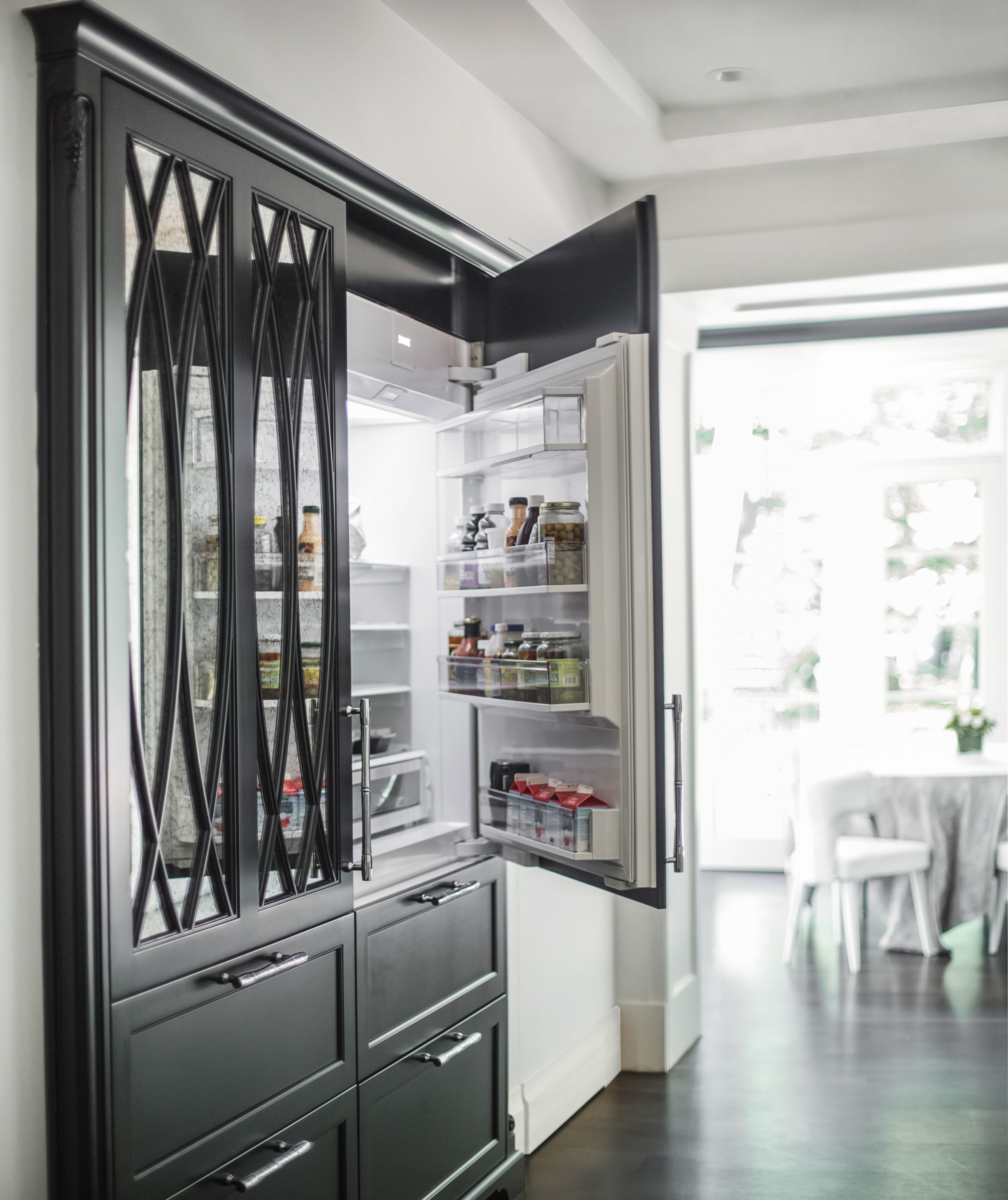 Black Kitchen with two Subzero refrigerators paneled to look like