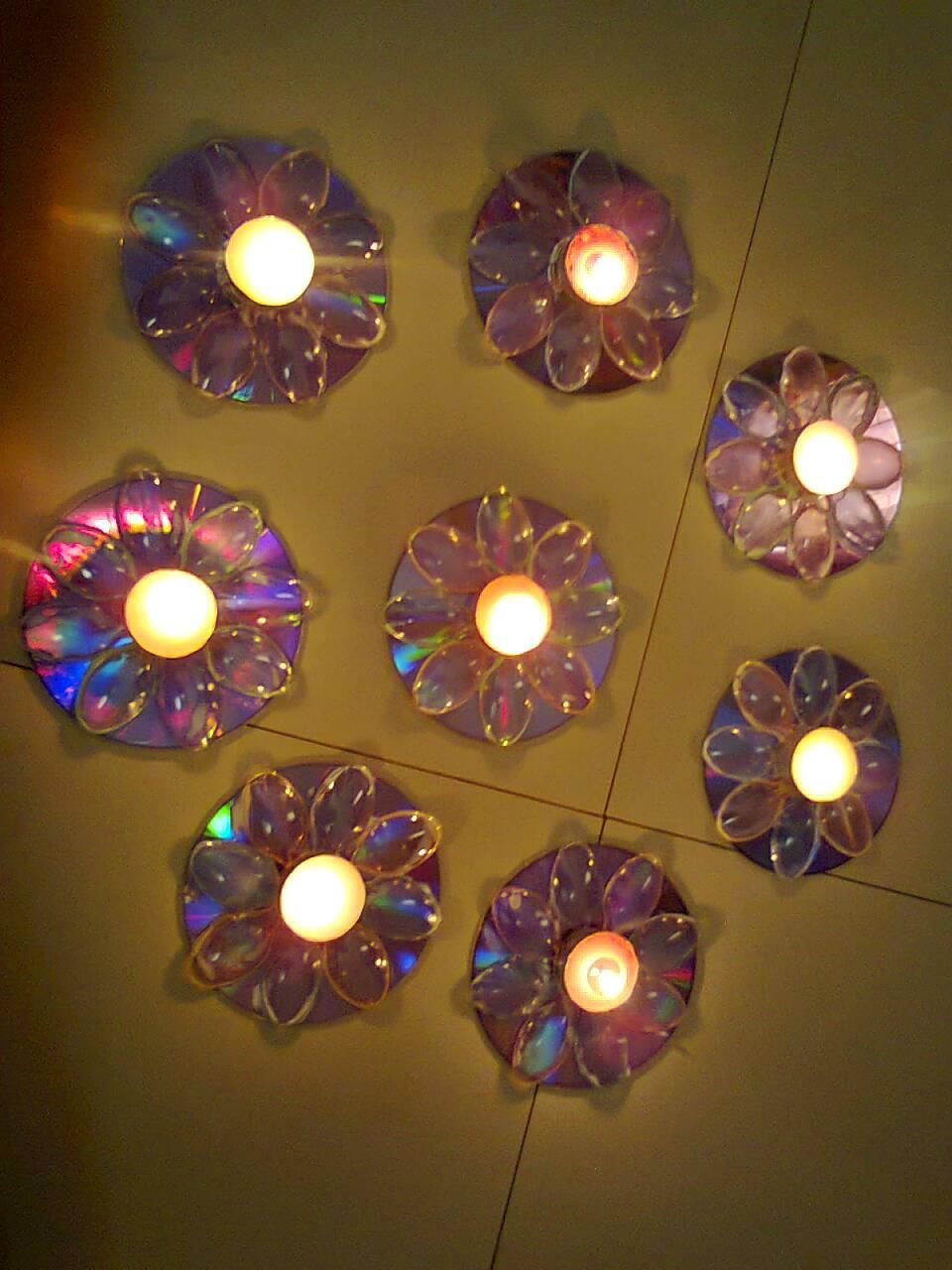 Beautiful candle holders created made out of old cd 39 s for Candle decoration with waste material