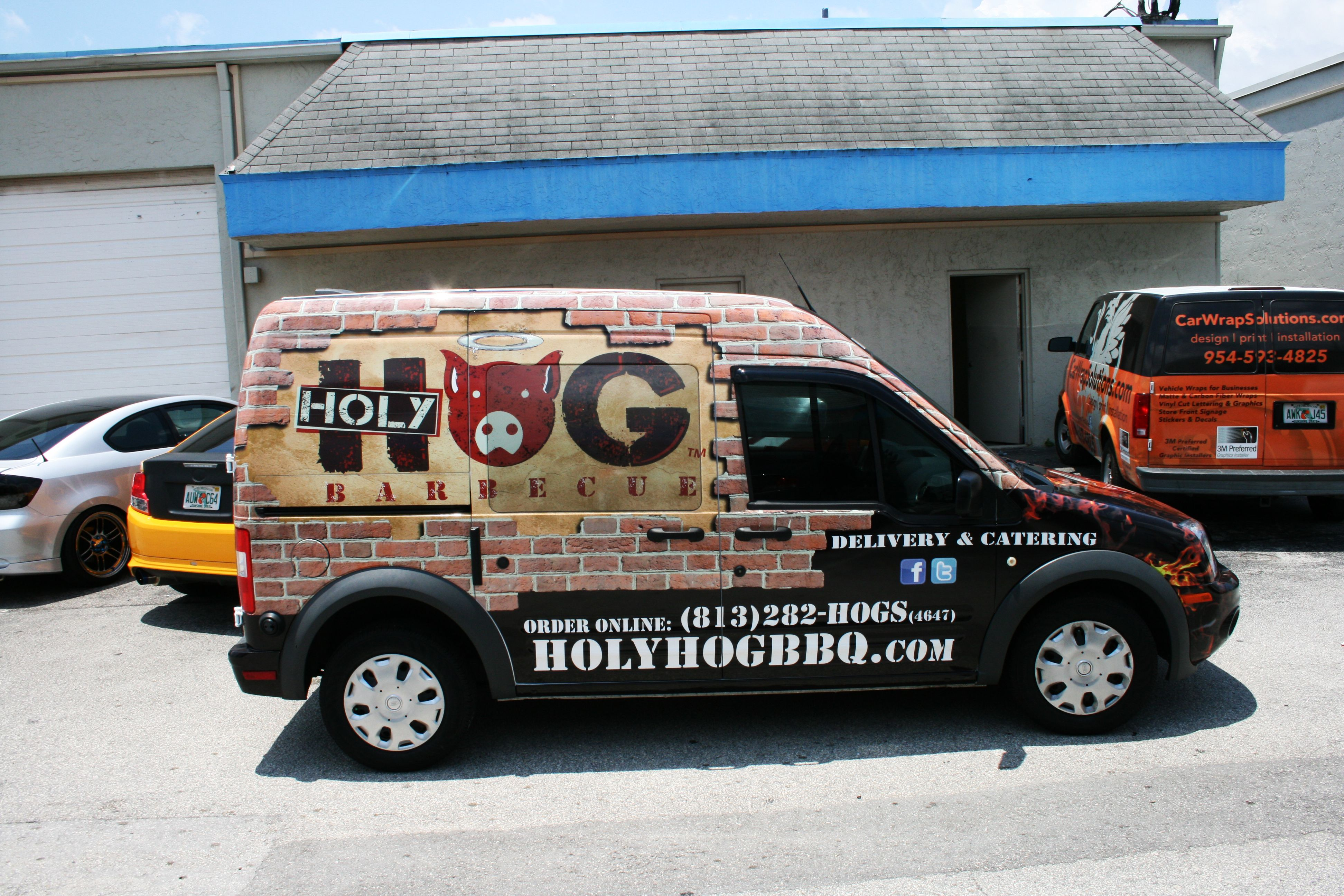 Ford transit connect van vehicle wrap tampa florida for holy hog barbecue restaurant http