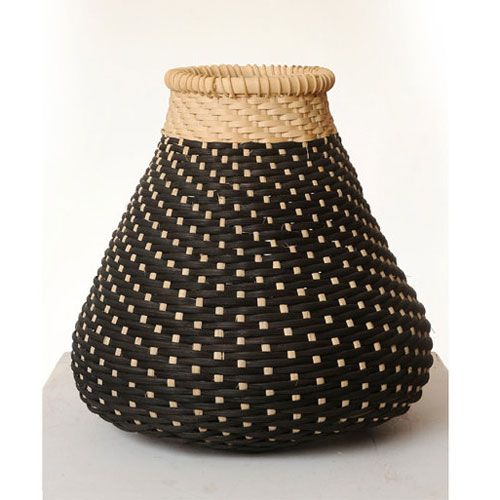 """This small """"cat head"""" shape basket is a wonderful gift for a new home or as a decorative piece in any space. http://www.mavestore.com/product/black-white-small-cat-head-basket"""