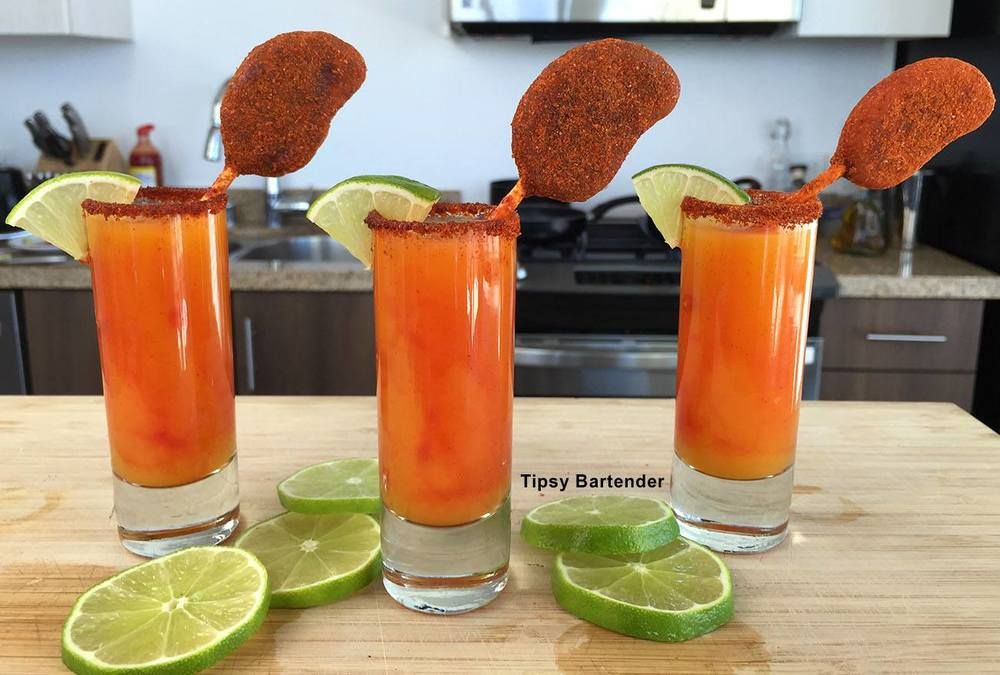 Spicy, fun and easy to make...MINI MANGONEADA SHOTS! For the recipe, visit us here: www.TipsyBartender.com