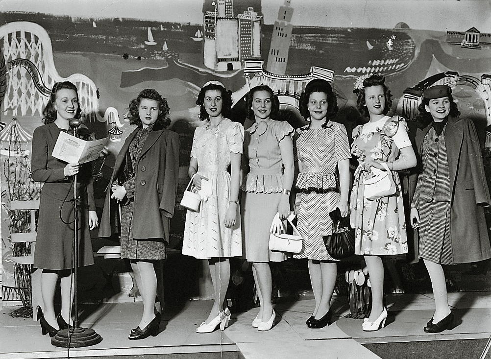A stylishly attired group of ladies models fashions for