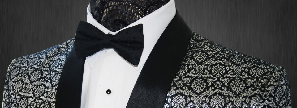 Midnight Black Formal evening wear Silver Jacquard Fully Lined with Black Silk hand stitched Soft and Luxurious feel Bespoke Tailored, 3 Cloth Buttons on cuffs Silk Shawl lapel 2 x Side Vents Ticket Pocket Great for formal evening wear if you wish to make an entrance.