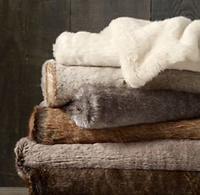 Fur is trending in home fashion right now.  Restoration Hardware has blankets and throws.