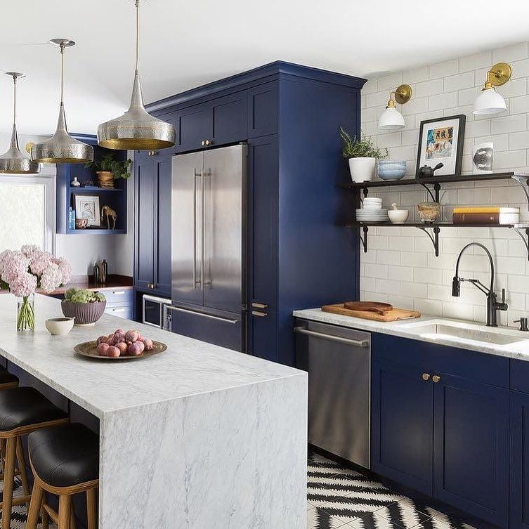 the solna articulating kitchen faucet in matte black complements rich blue cabinetry and high on kitchen cabinets design id=84059