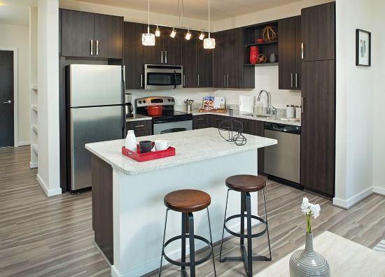 Avery Row Arlington Va Kaindl Naturaltouch Oak Spartansurfaces Laminateflooring Greenguard Multifamily Housing Modern Kitchen Luxury Apartments