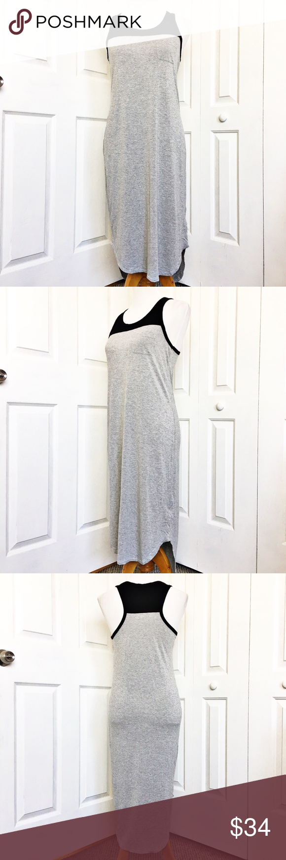 """Joe Fresh Maxi Dress Adorable dress by Joe Fresh.  Black and gray in color and features a scoop neck, curved hem, and from chest pocket.  Material is 100% rayon.  Measurements laid flat: bust 17"""", waist 17.5"""", hip 19"""" and length from top of shoulder to hem in front 41"""" and back 44.5"""".  EUC. Joe Fresh Dresses Maxi"""