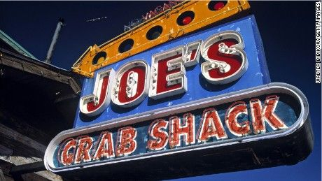 Customers at Joe's Crab Shack in Minnesota were disturbed when they discovered an authentic photo of two black men being hanged with a joke caption embedded inside of a decorative table at the restaurant.