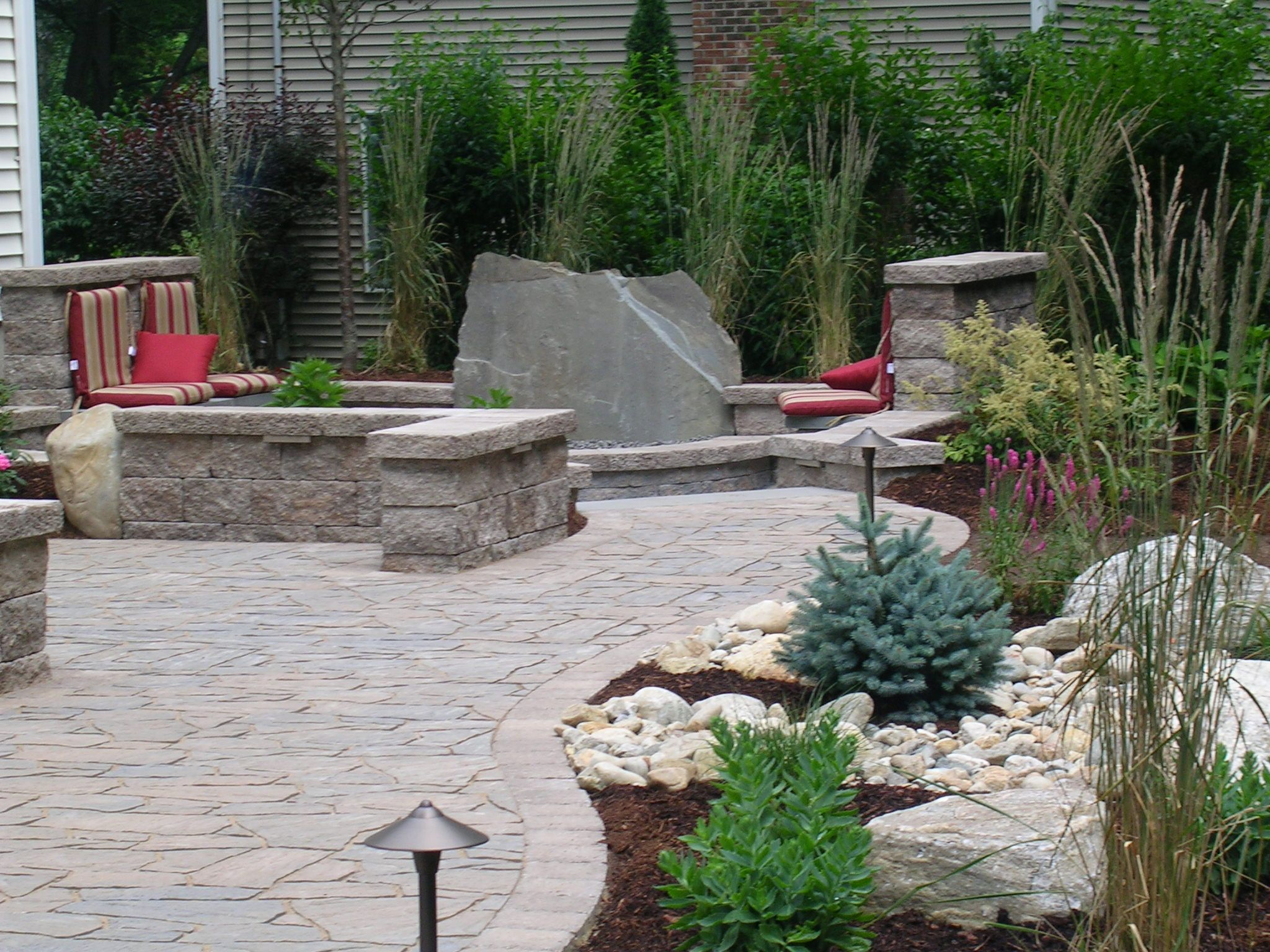 Landscaping And Landscape Lighting Frame A Paver Patio With Sitting Walls By Bahler Brothers